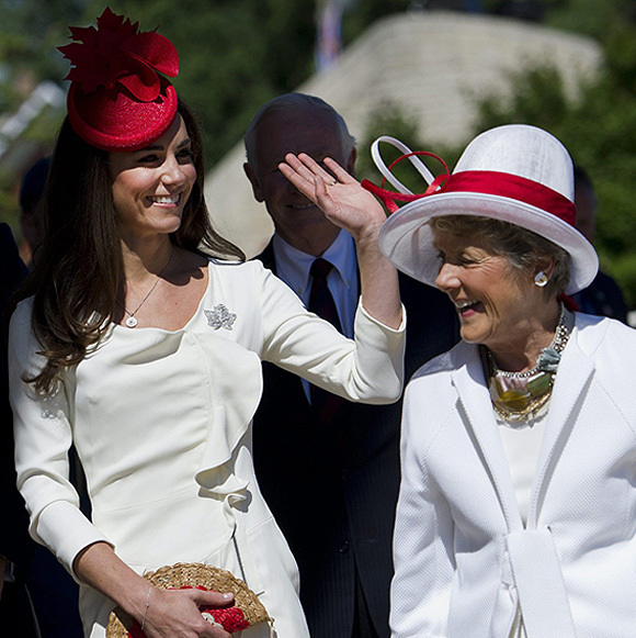 During the Canada visit, Kate again paid tribute to her hosts by wearing an outfit in red and white - the national colours. Her scarlet hat was in the design of the national symbol, the maple leaf, which matched her fire engine red court heels. The poised beauty had also borrowed a diamond brooch in the shape of the leaf from the Queen.