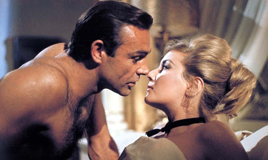 "Sir Thomas Sean Connery, better known as the original James Bond, inhabited the British spy from 1962 to 1971. Here, he gets close with co-star Daniela Bianchi in the 1963 film 'From Russia With Love'. At the age of 69, Sean was named the ""Sexiest Man of the Century"" by 'People' magazine in 1999. 