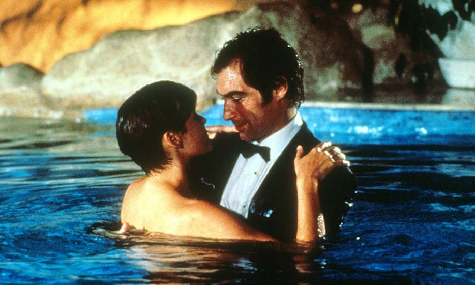 Welsh actor Timothy Dalton had a two-time run as Bond, his second and final performance in 'License to Kill' in 1989. In the film, Bond recruits ex-CIA agent and pilot Pam Bouvier, played by Carey Lowell, after rescuing her in Bimini bar. Naturally, the two find their way into a pool fully clothed!