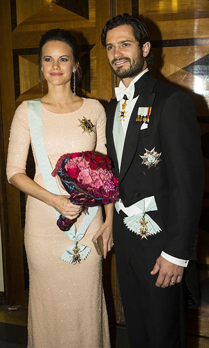 Radiant Princess Sofia, who's expecting her first child with Prince Carl Philip, joined her new husband at a formal gathering of the Royal Swedish Academy of Engineering Services, looking gorgeous in a sequinned blush gown.