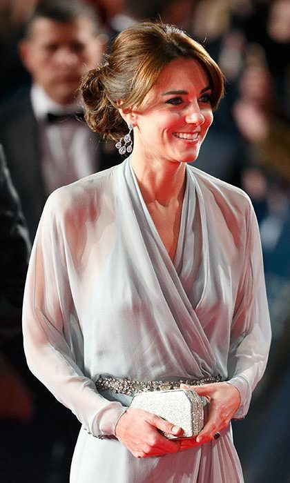 The Duchess of Cambridge was as radiant as ever as she joined Prince William and Prince Harry for the 'Spectre' premiere, wearing her hair up in a chic chignon and her bangs parted in the middle.