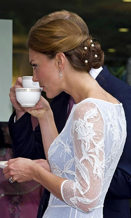 The mother of two accessorized her elegant low bun with some pearl bobby pins as she attended a tea party at the British High Commission Residence in 2012.