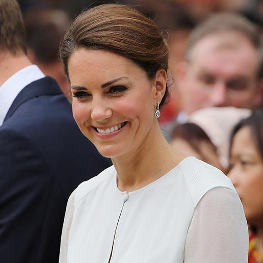 Not a hair was out of place as Kate stepped out with William during a visit to Kuala Lumpur, with her locks swept back into an elegant chignon parted on the side.