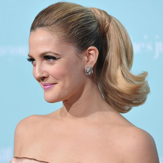 Drew Barrymore could have stepped out of old Hollywood with her chic short updo complemented by dramatic winged eyeliner.