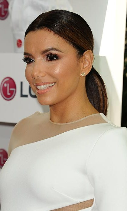 Eva Longoria chose a wet look low style to complement her long eyelashes and smokey eye make-up.