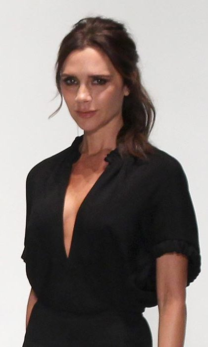 Victoria Beckham closed her successful New York Fashion Week show, taking to the catwalk with a laidback loose wavy style.