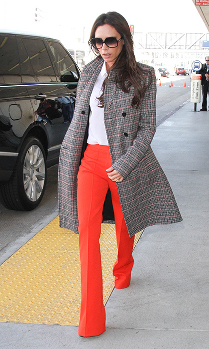 Victoria Beckham popped out of LAX on Oct. 26 in a tartan swing coat from her eponymous collection, which she paired with a crisp white shirt and bold red, flared trousers.
