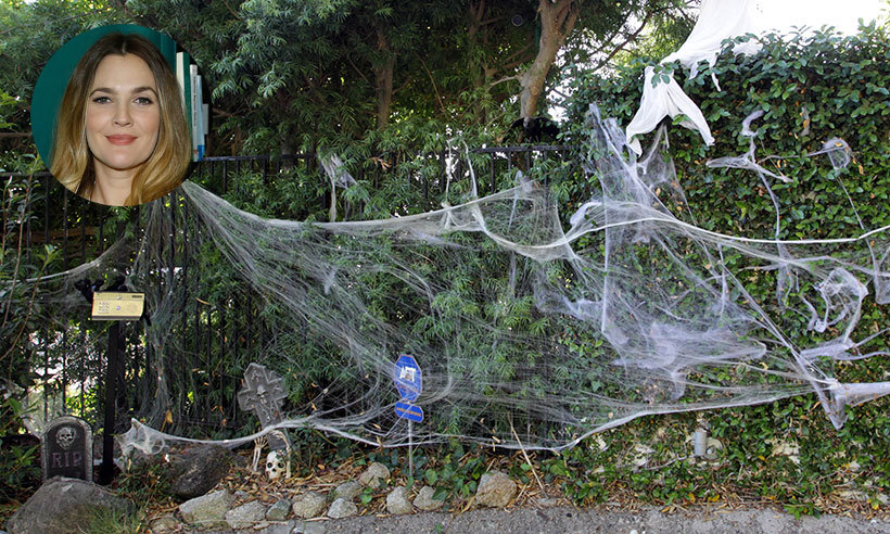 Drew Barrymore built a mini graveyard in front of her Hollywood home, complete with resurrected skeleton and cobwebs.