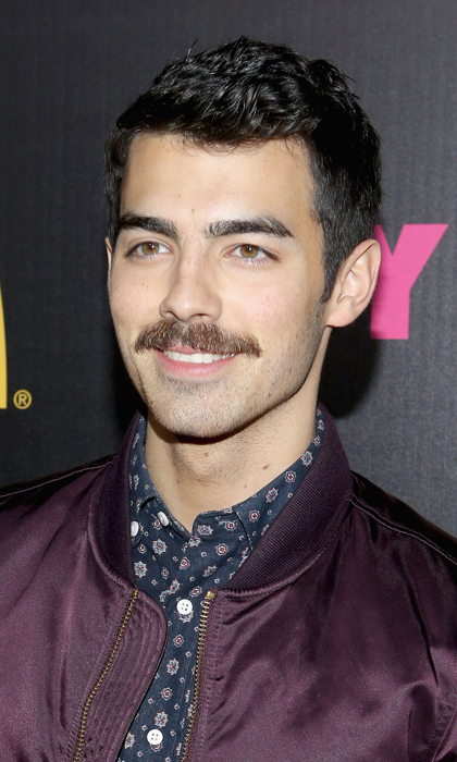 Before he had supermodel Gigi Hadid on his arm, Joe Jonas celebrated Movember with an admirably thick strip above his upper lip in 2013. The singer kept his 'stache well into December and came out with some awesome holiday cards. Well played!