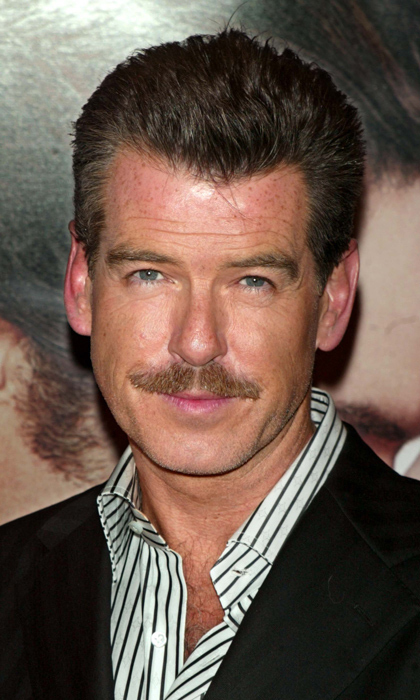 He didn't have his ticklers in the romantic comedy 'Laws of Attraction,' in which he starred opposite Julianne Moore, but Pierce Brosnan showed off his newfound facial hair on the promotion trail in 2004.
