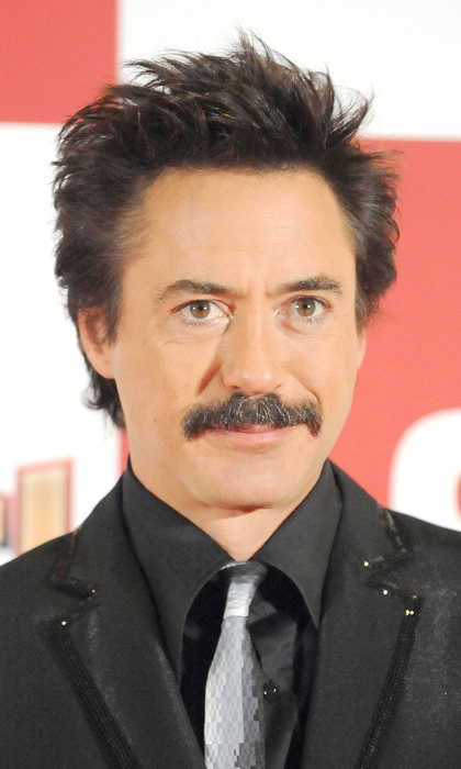 Robert Downey Jr. rocks facial hair as Iron Man, but at the film's 2008 Tokyo premiere he chose to axe the beard portion and rock a full-fledged moustache.