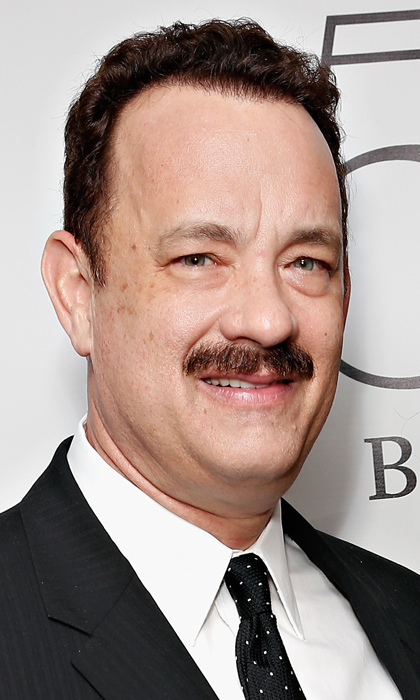 In 2013, a bushy lipped and bright eyed Tom Hanks was on hand to support wife Rita Wilson at 54 Below in New York. He later admitted that his wife hated the hair, which he grew for his role in 'Mr. Banks.'