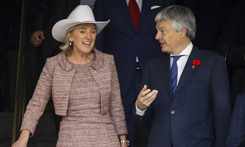 Yee-haw! Princess Astrid of Belgium and Belgian minister Didier Reynders depart a special welcoming ceremony held in their honour at Calgary's City Hall.  