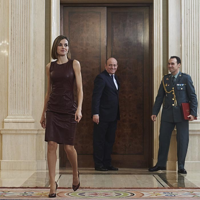 Stylish Queen Letizia of Spain recycled her burgundy Hugo Boss leather sheath dress to present at the 10th Yo Dona International Awards at Madrid's La Zarzuela Palace.  