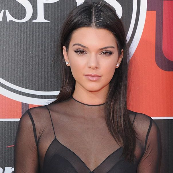 Rocking sleek glossy tresses with a middle parting and barely-there make-up save for a hint of mascara and eyeliner at the ESPY awards.
