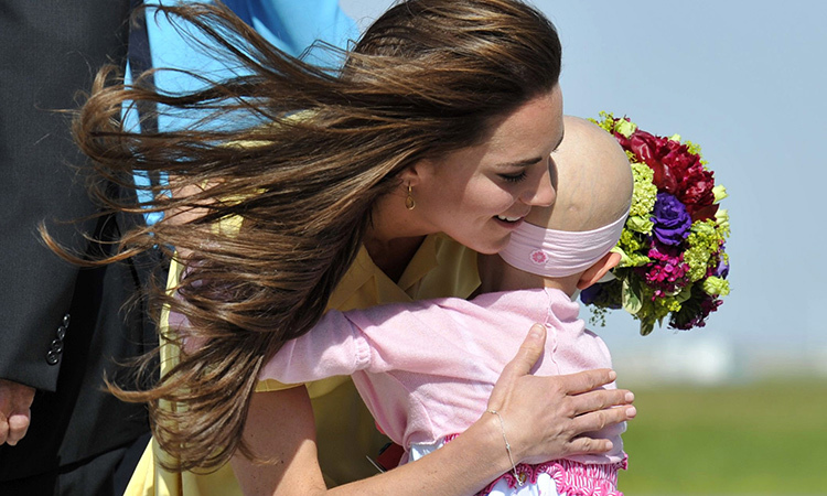 The Duchess of Cambridge received a warm hug from six-year-old Diamond Marshall at Calgary's international airport in 2011. Sadly, the brave youngster lost her battle to cancer in December 2014. 