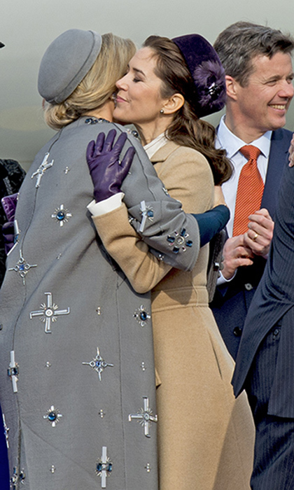 Royal besties Princess Mary of Denmark (R) and Queen Maxima of the Netherlands share an embrace on the tarmac at Copenhagen Airport during the start of a Dutch state visit in Mar. 2015.  
