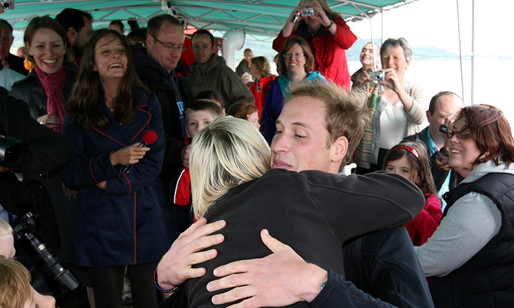 Eager mom-of-one Jo Holmes steals a hug from Prince William during the senior royal's visit to Ullswater in 2009. The Duke of Cambridge joined the charity WellChild for a sail around the the town's lake in a giant steamer boat. 