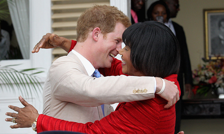 Prince Harry received a warm welcome from Jamaica's Prime Minister Portia Simpson Miller after he arrived in Kingston as part of the Queen's Jubilee Tour in 2012. 