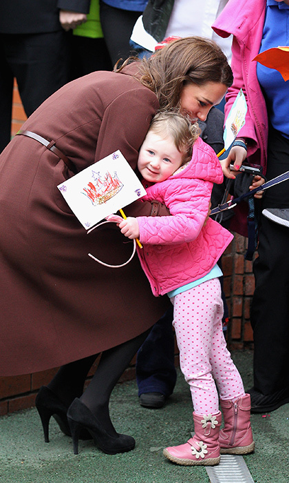 A little princess waiting outside the Alder Hey Children's NHS Foundation Trust shared a special moment with the Duchess of Cambridge during her visit to the centre in 2012. 
