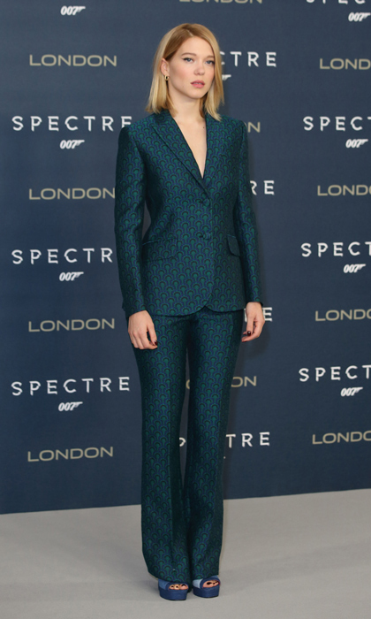 The Bond girl effortlessly pulls off menswear chic in a perfectly tailored, teal-patterned Miu Miu suit during a photocall in London. 