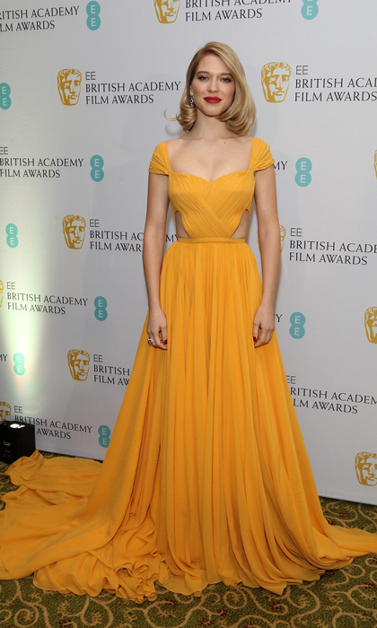 Léa stunned in an amber Prada gown with cap sleeves at the after-party for the 2015 EE British Academy Film Awards in London. 