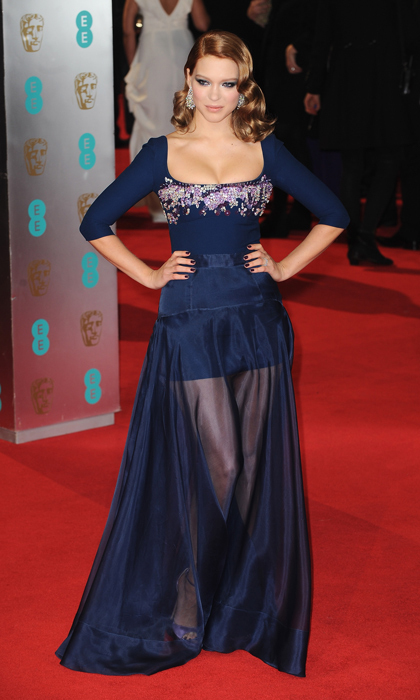 The bombshell beauty worked the 2014 BAFTA Awards red carpet in a décolletage-baring embroidered Miu Miu gown with sheer skirt. 