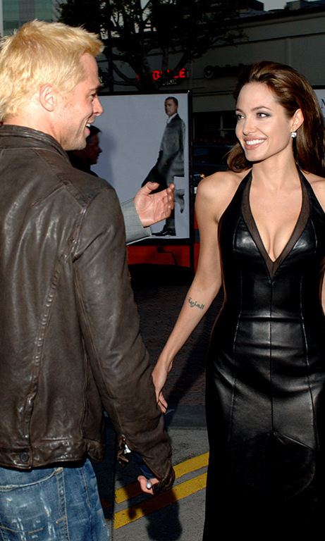 March 2005: A blond and newly single Brad – who'd split from wife Jennifer Aniston early that year – shared some banter with a leather-clad Angelina at the 'Mr. and Mrs. Smith' premiere in Los Angeles. Just a few months later the overjoyed pair confirmed their relationship.