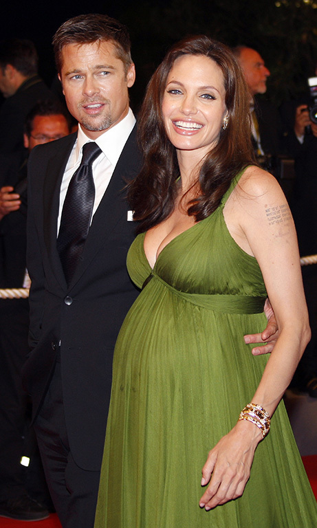 May 2008: Pregnant with twins Knox and Vivienne, Angelina glowed as she was escorted down the red carpet by Brad at the 'Kung Fu Panda' premiere in Cannes. 