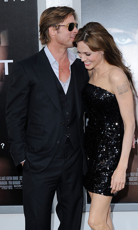 July 2010: The A-list couple seemed to be swapping secrets (or sweet nothings!) during the premiere of 'Salt' in Los Angeles. 