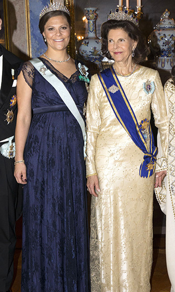 Princess Victoria of Sweden, who is pregnant with her second child, joins Queen Silvia at a state banquet at the Royal Palace in Stockholm.