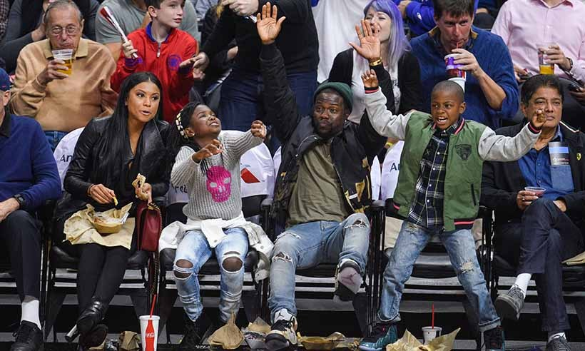 Comedian Kevin Hart and his kids leap for joy as they watch the Los Angeles Clippers take on the Phoenix Suns at the Staples Center on Nov. 2. 