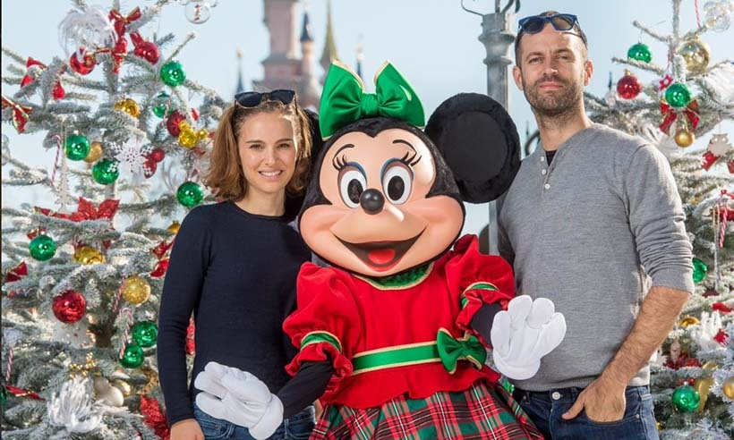 Minnie Mouse welcomes Natalie Portman and her husband Benjamin Millepied to Disneyland in Paris. 