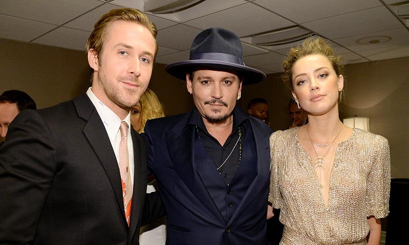 Ryan Gosling catches up with Johnny Depp and Amber Heard at the 19th Annual Hollywood Film Awards in Beverly Hills. 