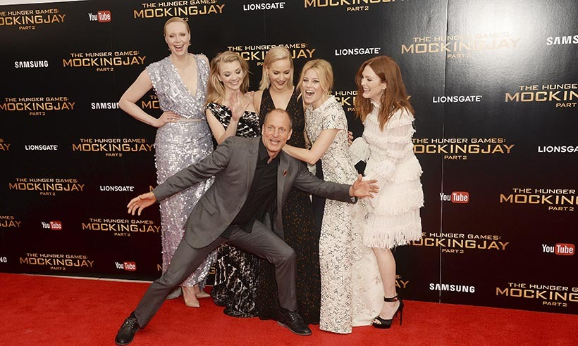 Woody Harrelson photobombs the ladies of 'The Hunger Games: Mockingjay - Part 2' (From left: Gwendoline Christie, Natalie Dormer, Jennifer Lawrence, Elizabeth Banks and Julianne Moore) at the film's premiere in London. 