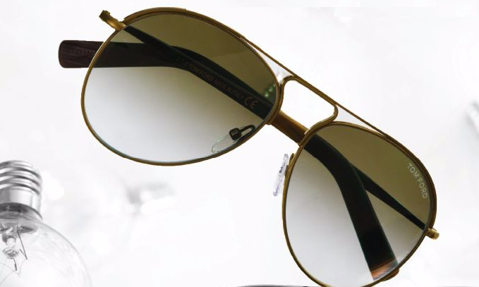 Tom Ford antique shiny light gold metal vintage Cody aviator with gradient brown lens, $465, holtrenfrew.com.