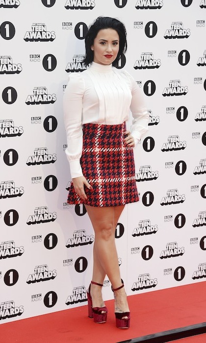 Demi Lovato matched her lips to her tartan miniskirt as co-host of BBC Radio 1's Teen Awards in London. 