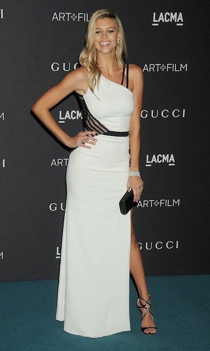 Leonardo DiCaprio's lady love Kelly Rohrbach was a vision in white as she supported her beau, who acted as host of the LACMA Art+Film gala in LA. 