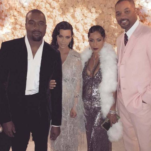 Kanye and Kim posing with Will Smith and Jada Pinkett Smith.