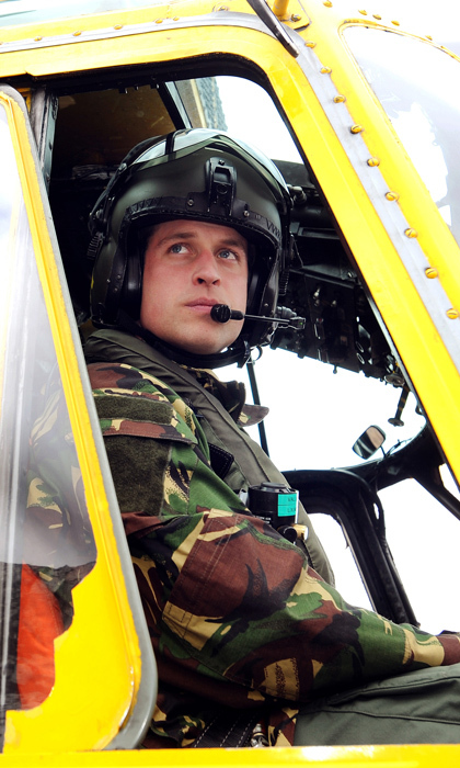 Prince William is seen sitting at the controls of a Sea King helicopter during a training exercise for rescue pilots. He has served with the Household Cavalry (Blues and Royals), the Royal Air Force and as an RAF search and rescue pilot.