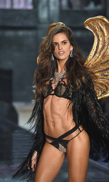 Izabel Goulart makes a case for black fringe and gilded wings.