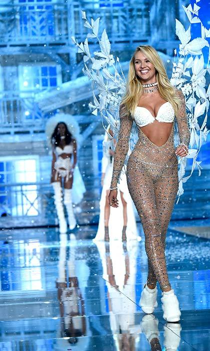 "Candice Swanepoel opened the winter portion of the show as a white-clad Ellie Goulding sang ""Love Me Like You Do"" and glistening snow fell from the ceiling.