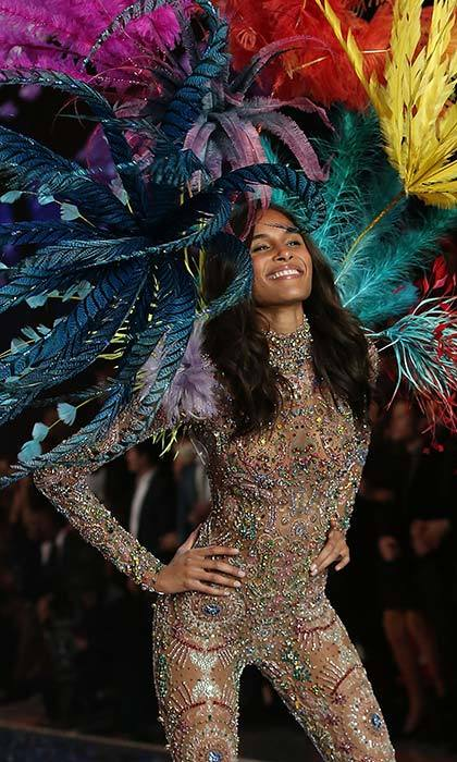 Baby you're a firework! Cindy Bruna dazzled in an embroidered jumpsuit and feathered wings.