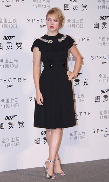 "French actress Léa Seydoux is effortlessly ladylike in a retro-inspired Miu Miu Fall 2015 dress with an embellished collar and silver heels at the ""Spectre"" press conference in Beijing. 