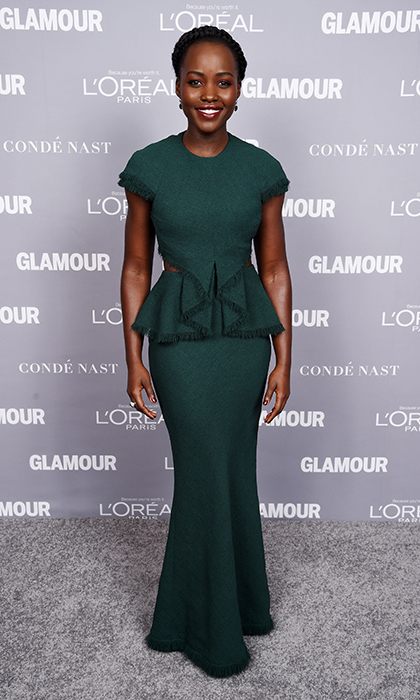Oscar winner Lupita Nyong'o is luminous in a floor-length forest-green Jason Wu gown with a fringed peplum. 