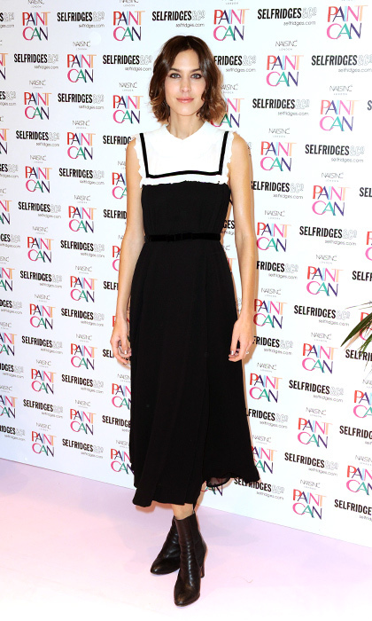 """It"" girl Alexa Chung is polished with just a touch of edge in this ruffled black-and-white collared dress and black boots at the launch of Paint Can Polish by Nails Inc. in Manchester, England. 