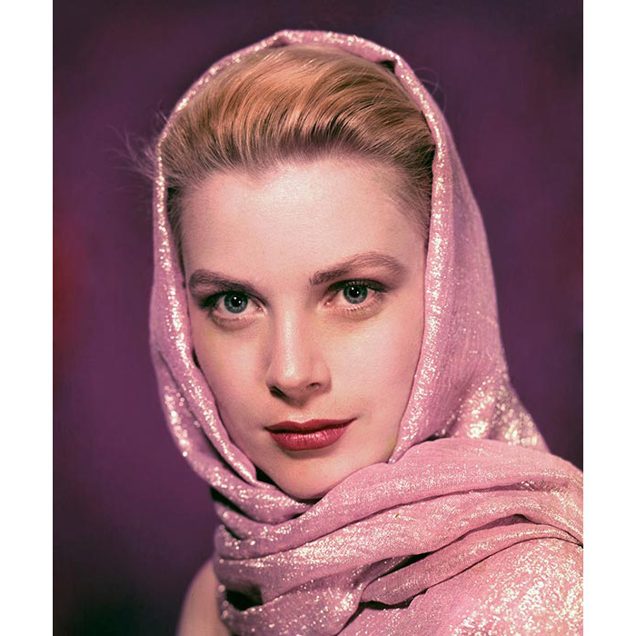 Complementing a shimmering pink scarf with a statement lipstick and a hint of eye makeup for a studio portrait