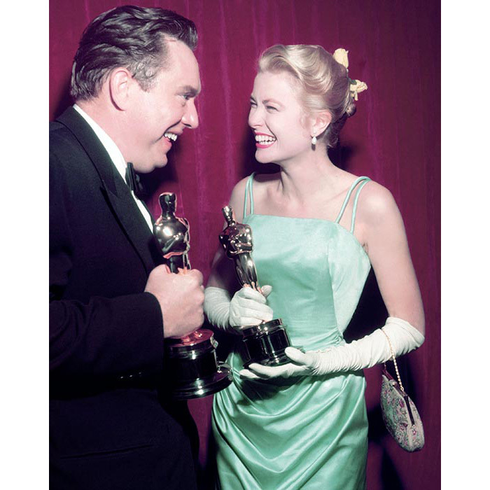 Opting for an elegant chignon with a floral hairpiece and minimal makeup for the 1955 Oscars where she won the Best Actress trophy for <em>The Country Girl</em>