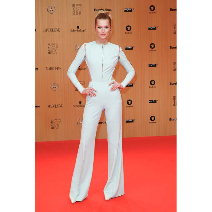 Model <strong>Toni Garrn</strong> rocked a white cut-out jumpsuit that showed off her slender figure.