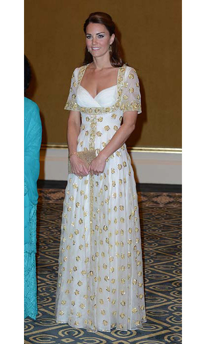 The duchess was elegant at a state dinner in Malaysia, wearing a custom Alexander McQueen dress by Sarah Burton. The gold embroidery recalls hibiscus, Malaysia's national flower.